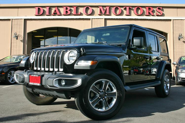 2019 Black /Black Jeep Wrangler Unlimited Sahara 4WD (1C4HJXEN0KW) with an 2.0L L4 DOHC 16V TURBO engine, Automatic with Overdrive transmission, located at 2067 San Ramon Valley Blvd., San Ramon, CA, 94583, (925) 830-8747, 37.738945, -121.952454 - Photo #0