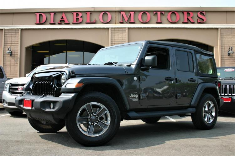 2019 Granite Crystal /Black Jeep Wrangler Unlimited Sport (1C4HJXDG0KW) with an 3.6L V6 DOHC 24V FFV engine, 6 Speed Manual transmission, located at 2067 San Ramon Valley Blvd., San Ramon, CA, 94583, (925) 830-8747, 37.738945, -121.952454 - Photo #0