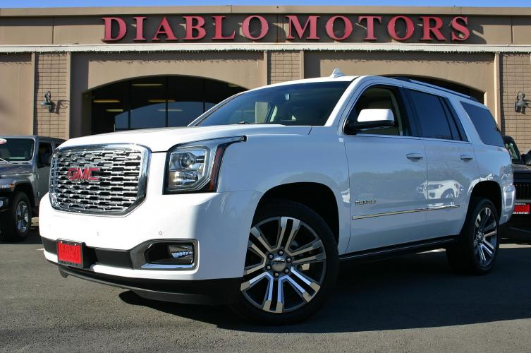 2018 GMC Yukon Denali 4WD, 6.2 liter V8, moonroof, DVD, navigation, heated and cooled leather seats, 2nd row capt chairs, tow pkg, MORE!